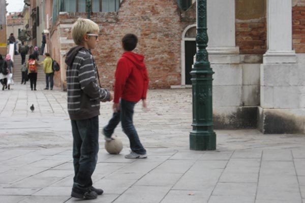 Children playing soccer in Venice, Italy