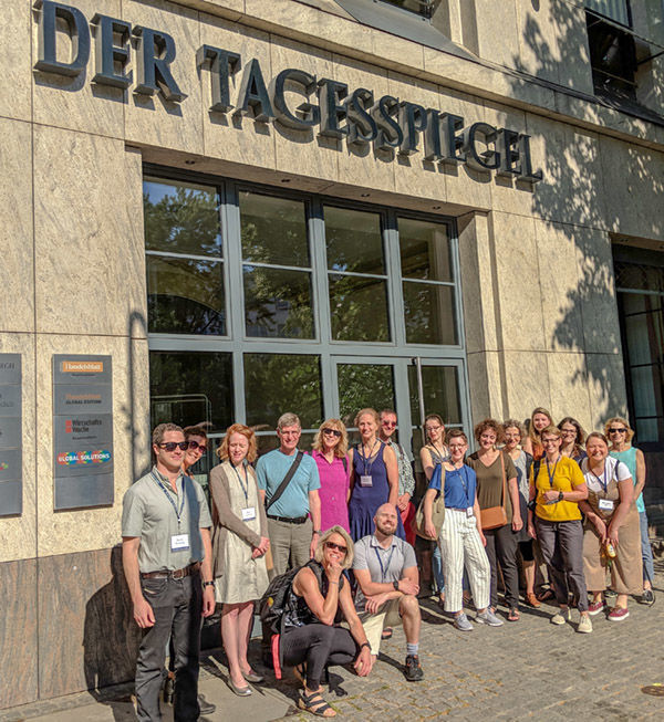 Notre Dame Berlin Seminar Cohort Meeting With Berlin Newspaper Outside Group Shot